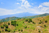 View on Etna and green sicilian hills in summer day — Stock Photo