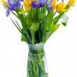 Bunch of flowers in glass vase — Stock Photo