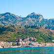 View on Taormina - tourist  resort  on mountain and Giardini Naxos beach, S — Stock Photo