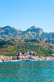 View on Taormina - tourist resort on mountain and Giardini Naxos beach, S — Stock Photo