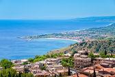 Town Taormina and resort Gardini Naxos on Ionian coast — Stock Photo