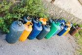 Gas bottles on street — Stock Photo