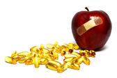 Apple and Capsules — Stock Photo