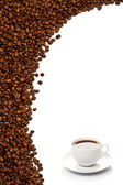 Coffee cup and grain on white background — Stock Photo