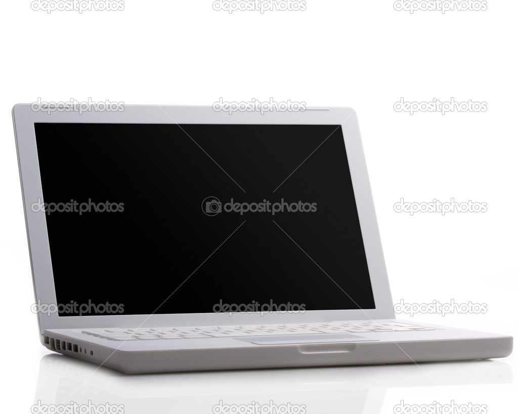 Modern laptop isolated on white with reflections on glass table.  Stock Photo #5701254