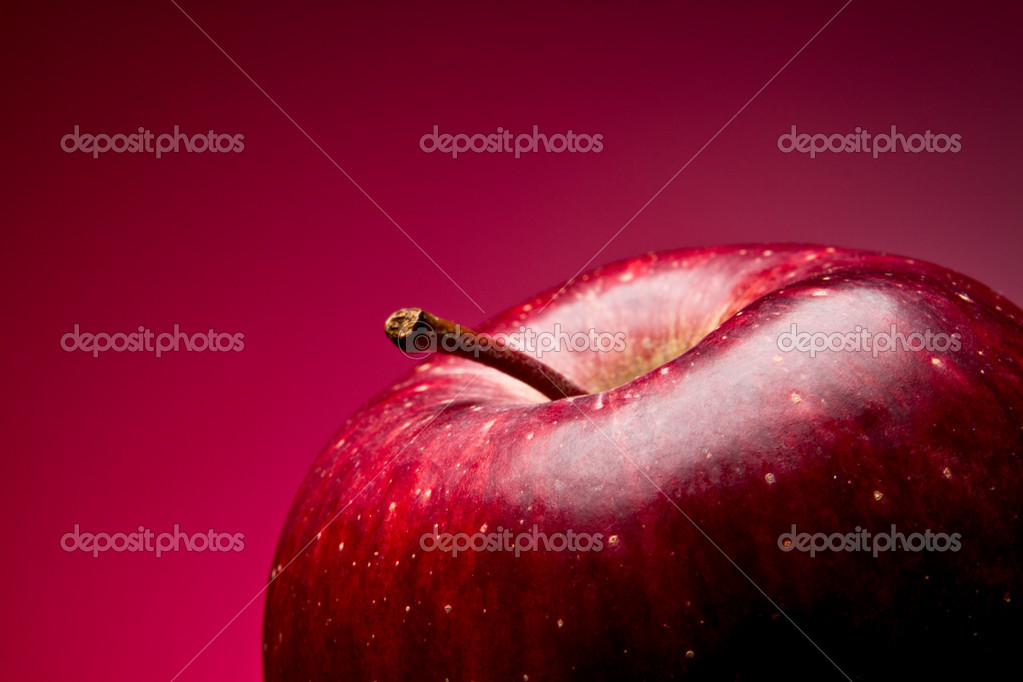 Red apple. Macro. on a red gradient — Stock Photo #5701688
