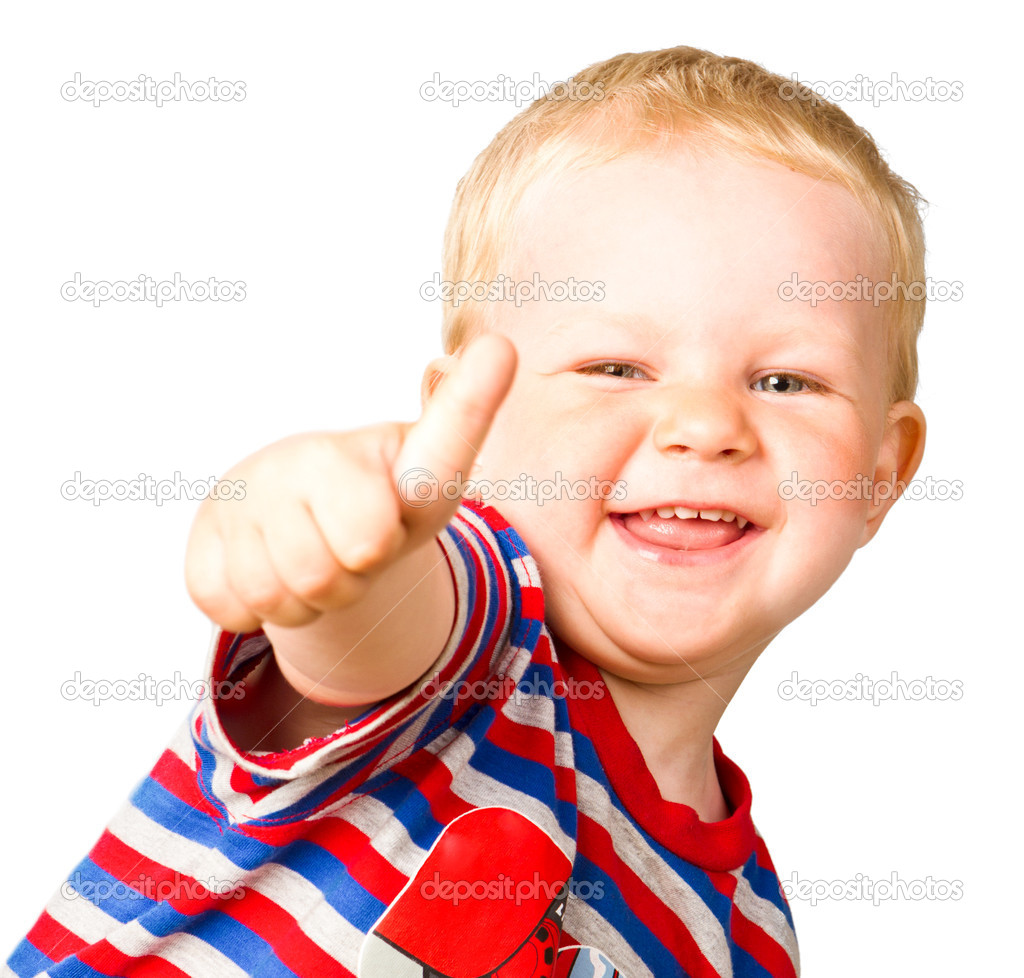 A happy boy is showing thumbs up isolated on the white background — Stock Photo #5843392