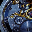 Clockwork macro isolated over the black background - Stock Photo