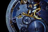 Clockwork macro isolated over the black background — Stock Photo