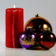 Red candle with christmas tree ball — Stok fotoğraf