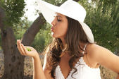 Girl with cap kiss — Stock Photo