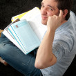 Stock Photo: Student man with his book in camera