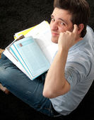 Student man with his book in camera — Stock Photo