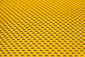 Yellow metal grille — Stock Photo