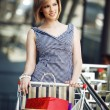 Beautifull woman with shopping cart — Stock Photo #5711739