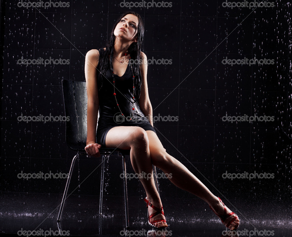 Young sexy woman sitting. Water studio photo. — Stock Photo #5711856