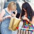 Beautiful young women after shopping - Stockfoto