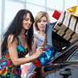 Girl-friends after shopping — Stock Photo #5738701