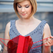 Beautiful blond with shopping bag — Stock Photo