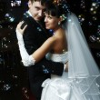 Bride and groom dancing — Stock Photo #5739045