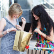 Stock Photo: Beautiful young women after shopping