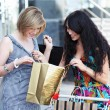 Beautiful young women after shopping - Stock Photo