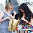 Beautiful young women after shopping — Stock Photo