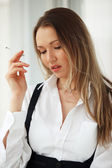Sad woman smoking — Stock Photo
