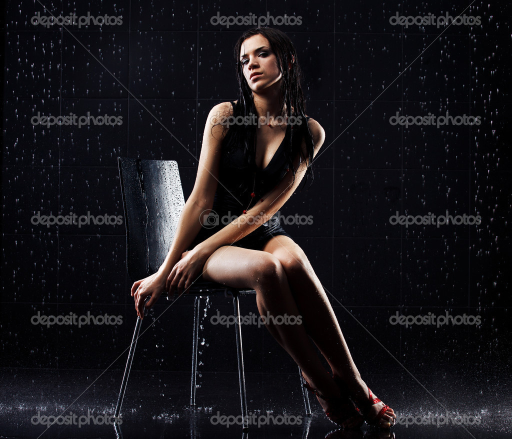 Young sexy woman sitting. Water studio photo. — Stock Photo #6429066