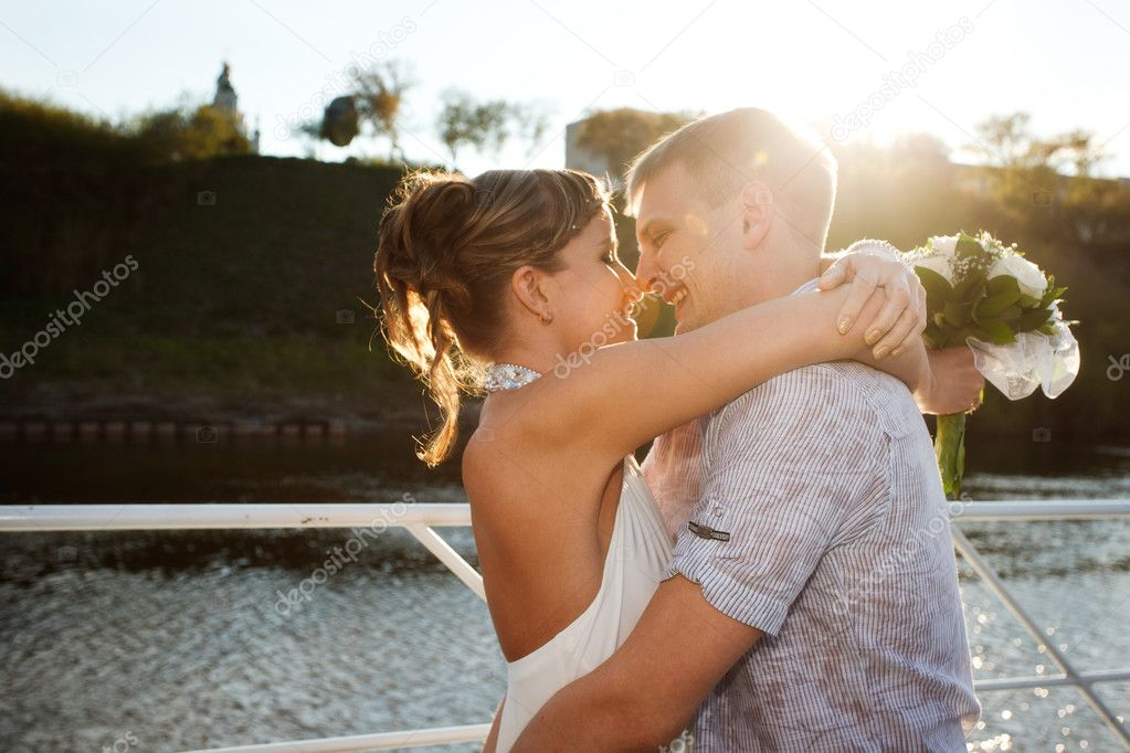 Young love Couple kissing on the deck   Stock Photo #6429224