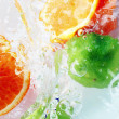Stock Photo: Fruits and water