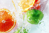 Fruits and water — Stock Photo