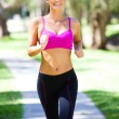 Portrait of a young woman jogging — Stock Photo #5706624