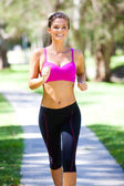Portrait of a young woman jogging — Stock Photo