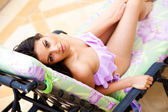 Young Woman Lounging in a Bathing Suit — Stock Photo