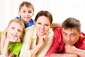 Beautiful family in the room — Stock Photo