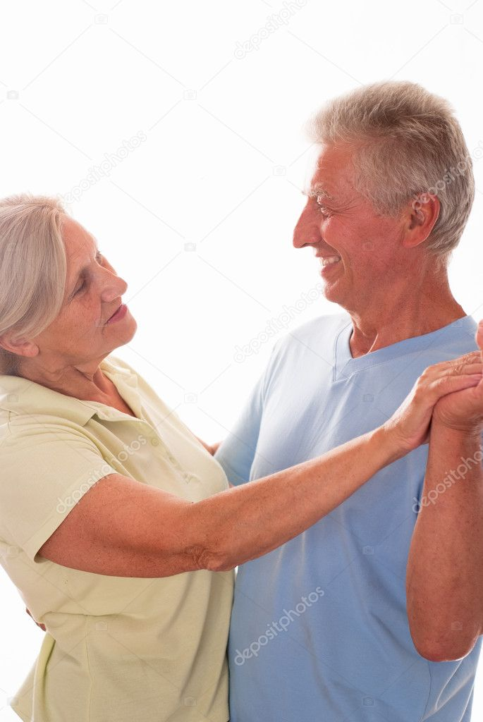 Elderly couple dancing on a white background — Stock Photo #5759803
