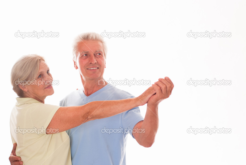 Elderly couple dancing on a white background — Stock Photo #5759814