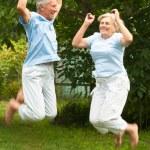Happy couple jumping — Stock Photo