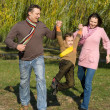 Happy family of three on the nature — Stock Photo #5761398
