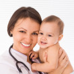 Beautiful doctor with newborn — Stock Photo