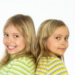 Smiling twins on white — Stock Photo