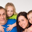 Portrait of happy family of four — Stok fotoğraf