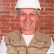 Old builder in the helmet — Foto Stock