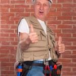 Senior builder on wall background — Stock Photo