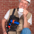 Senior builder on wall background — Stock Photo