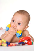 Nice baby with toys — Stock Photo