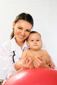 Doctor with a baby — Stock Photo
