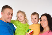 Portrait of happy family of four — Стоковое фото