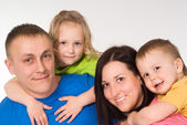 Portrait of happy family of four — Stockfoto